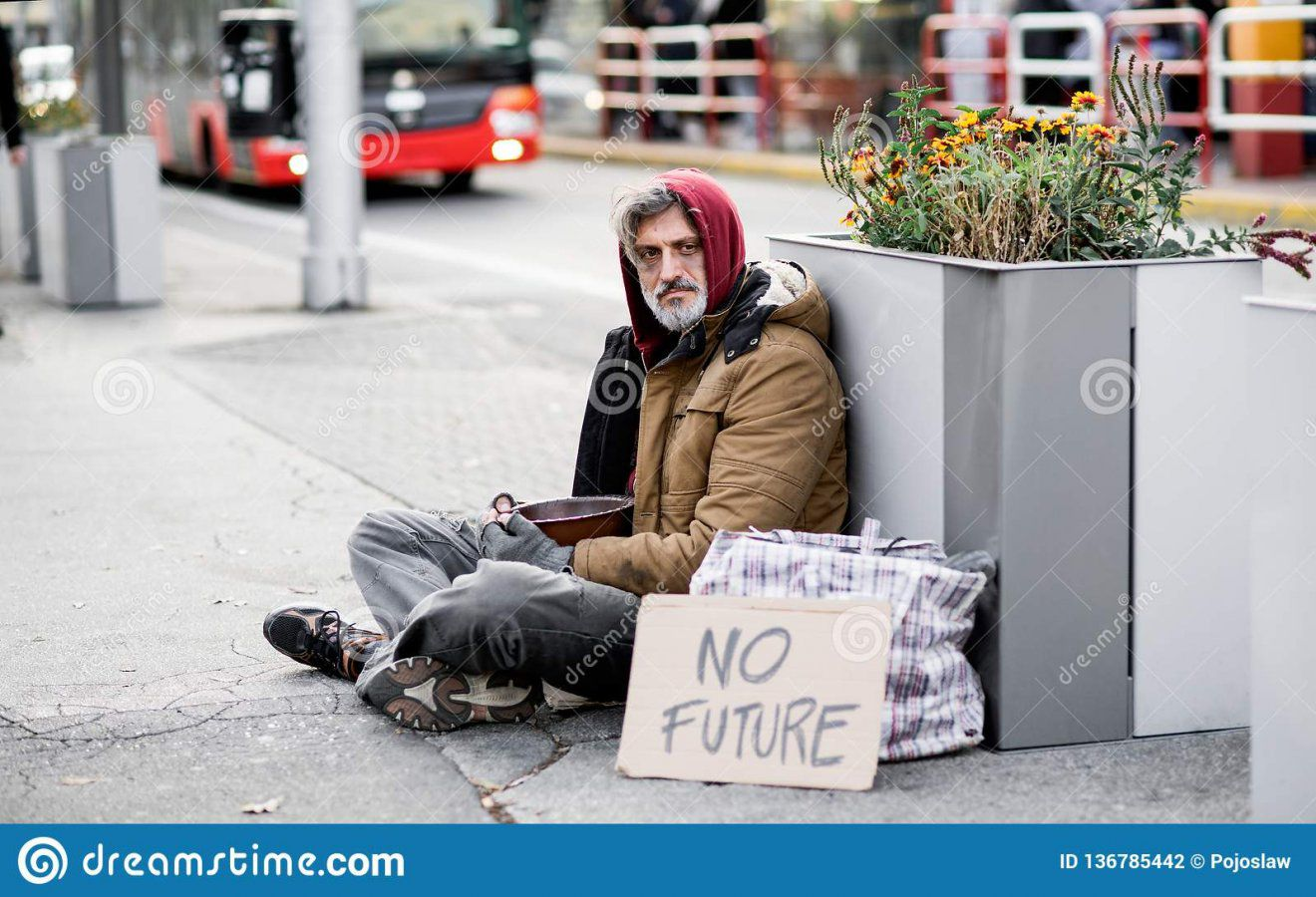 homeless-beggar-man-sitting-outdoors-city-asking-money-donation-carboard-sign-136785442.jpg
