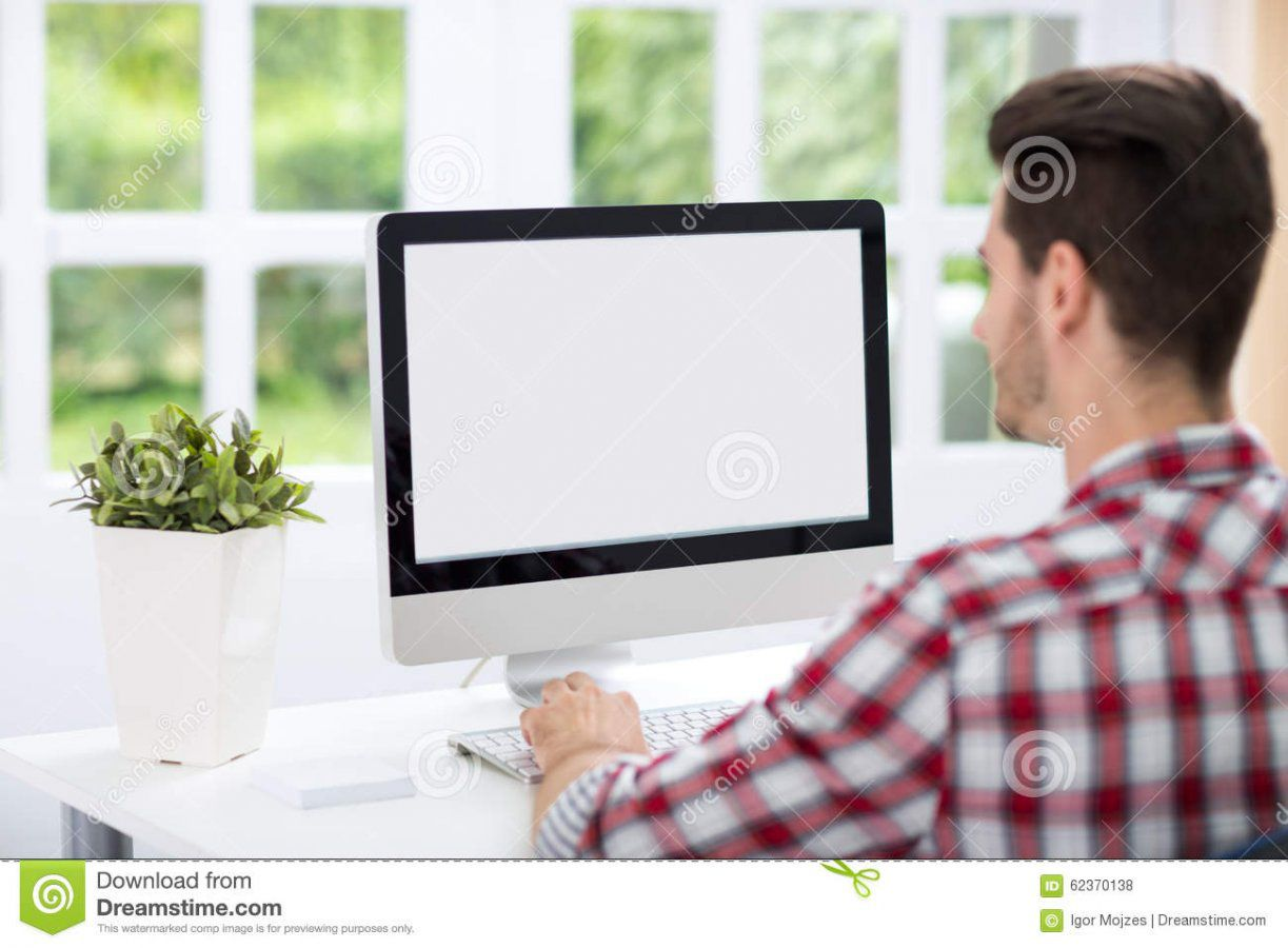 young-man-looking-computer-screen-home-office-62370138.jpg